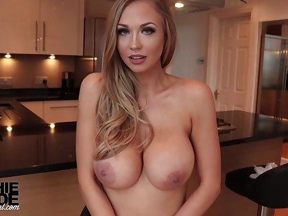 Killer, towheaded housewife with immense, rock-hard milk cans, Sophie Reade is doing some posing nigh the kitchen