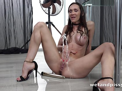 Sexy bitch is pissing standing with the addition of masturbating pussy