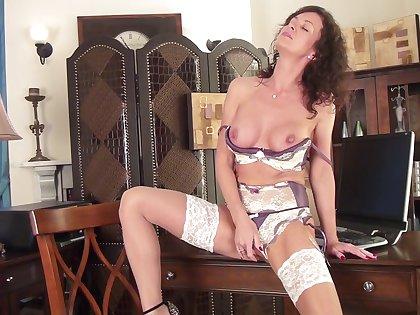 Despondent mature amateur Lucy Heart drops her panties to masturbate