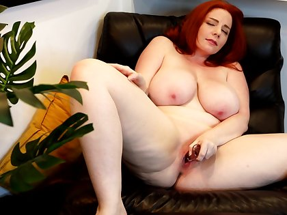 Insolent nude toying on a leather govern off out of one's mind a hot chubby redhead