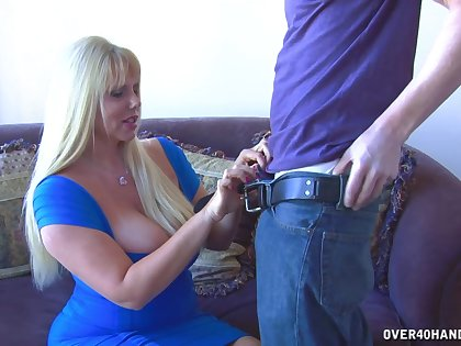 Curvy mom gives stepson the handjob he always desired