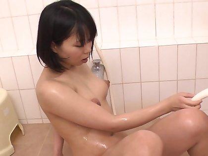 Horny Japanese girl Mikan Kururugi masturbates in the bathroom